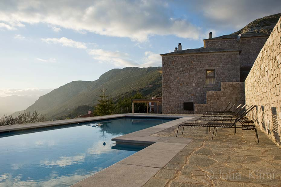 Modern house exterior with swimming pool and mountains view