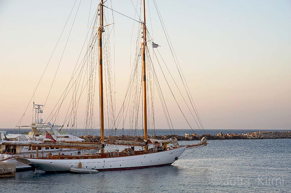 Sailing boat at the port of Fry, Kassos island, Dodecanese, Greece