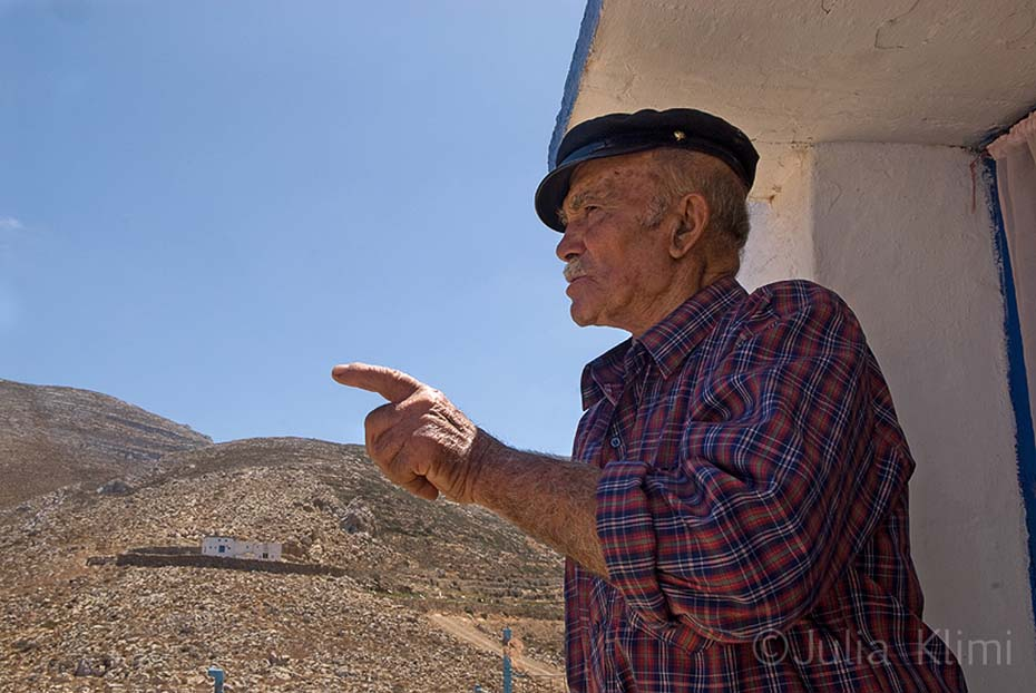 "Local shepherd in his ""mitato"" shepherds' huts, Kasos island"