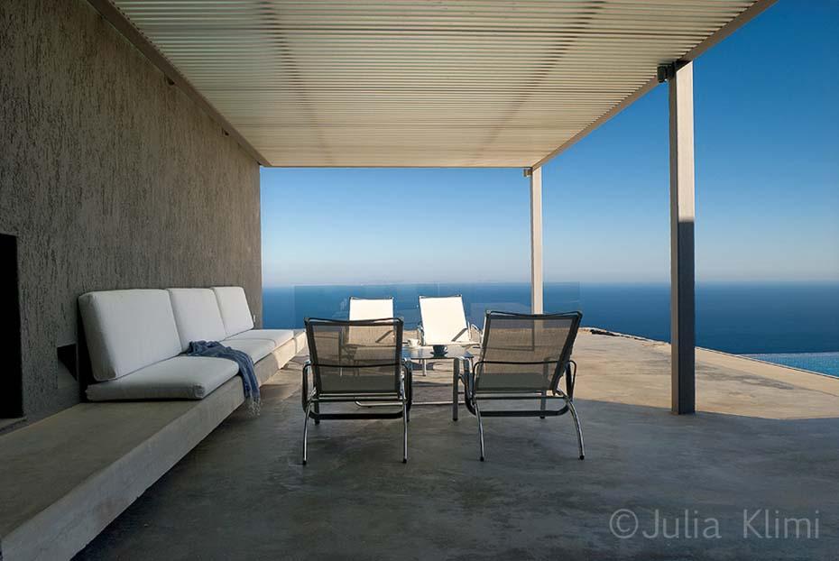 02DSC_4092 Modern terrace with loungers looking sea landscape