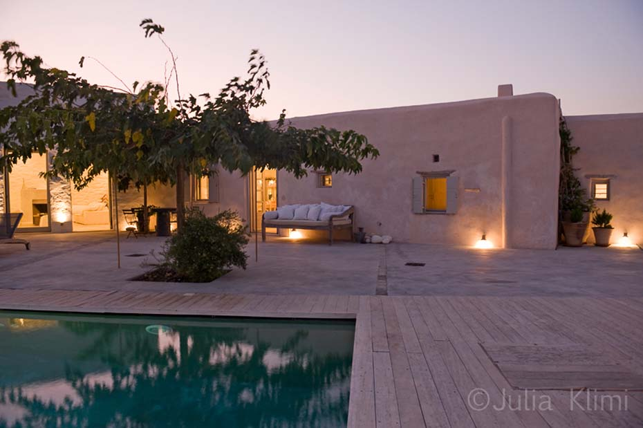 Classic island terrace with swimming pool at night time